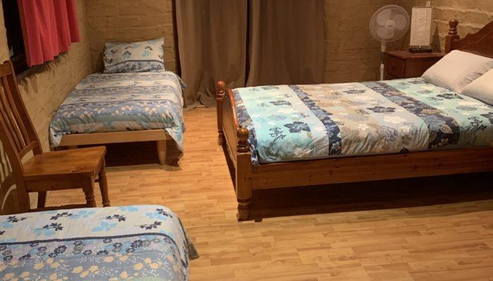 Bedroom 1 Queen plus 2 single beds